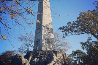 Wheelchair in front of obelisk